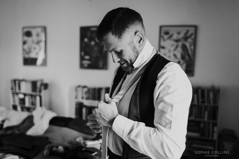 groom doing his tie