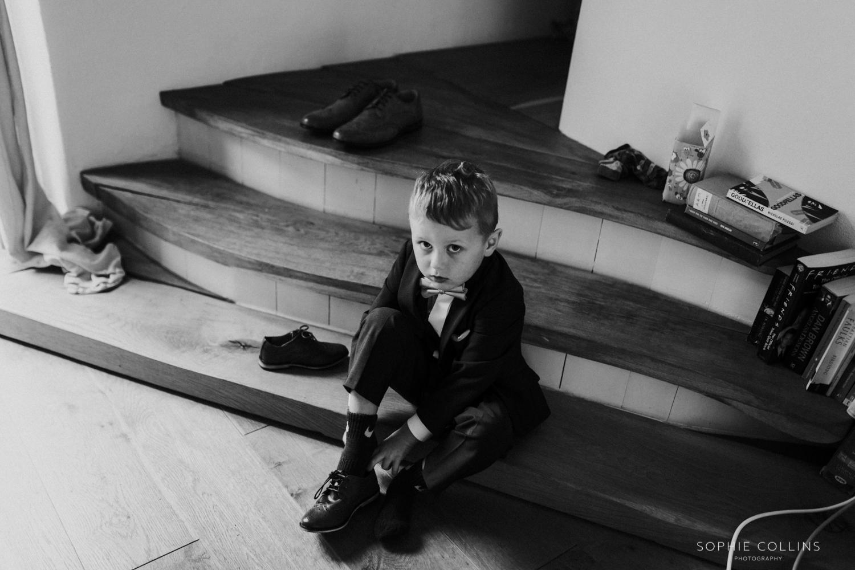 little boy doing his tie