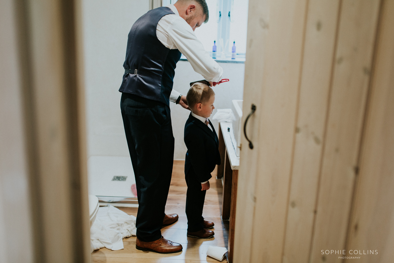 groom doing little boys hair
