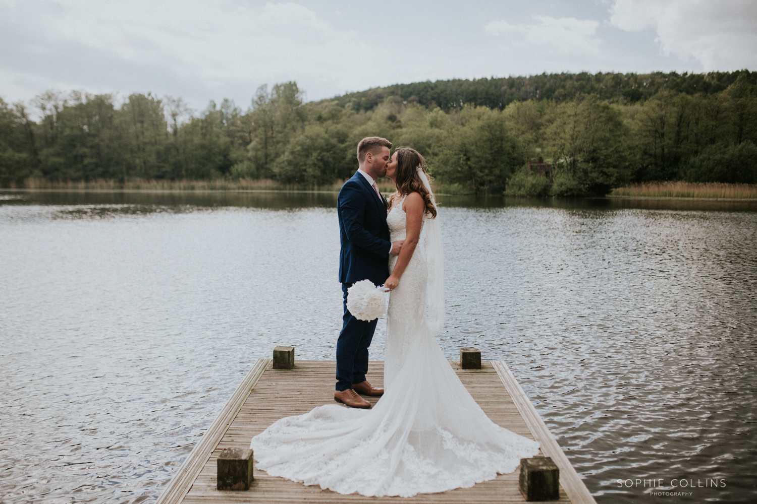 bride and groom at the lake