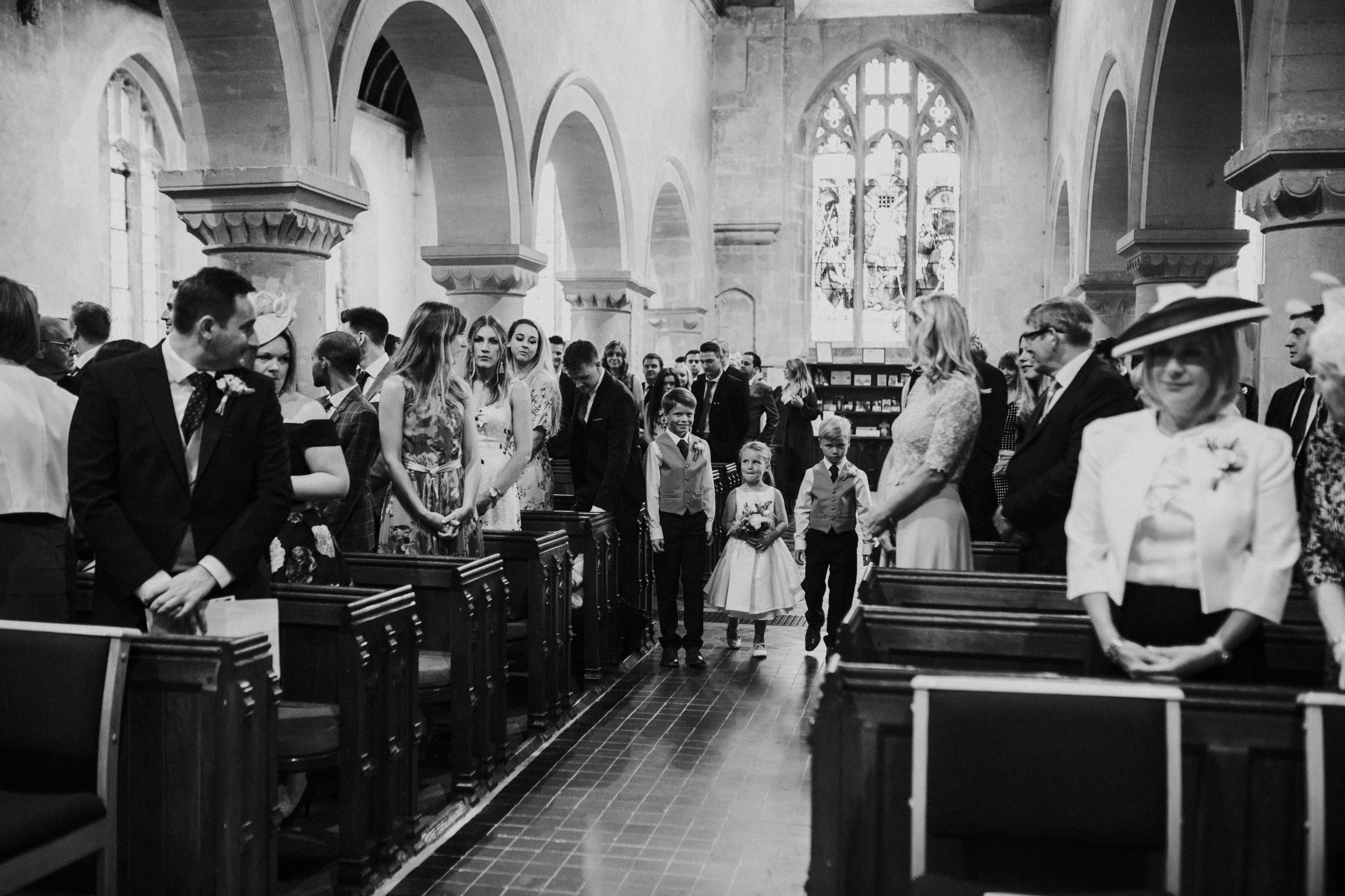 flower girl and Page boys walk down the aisle