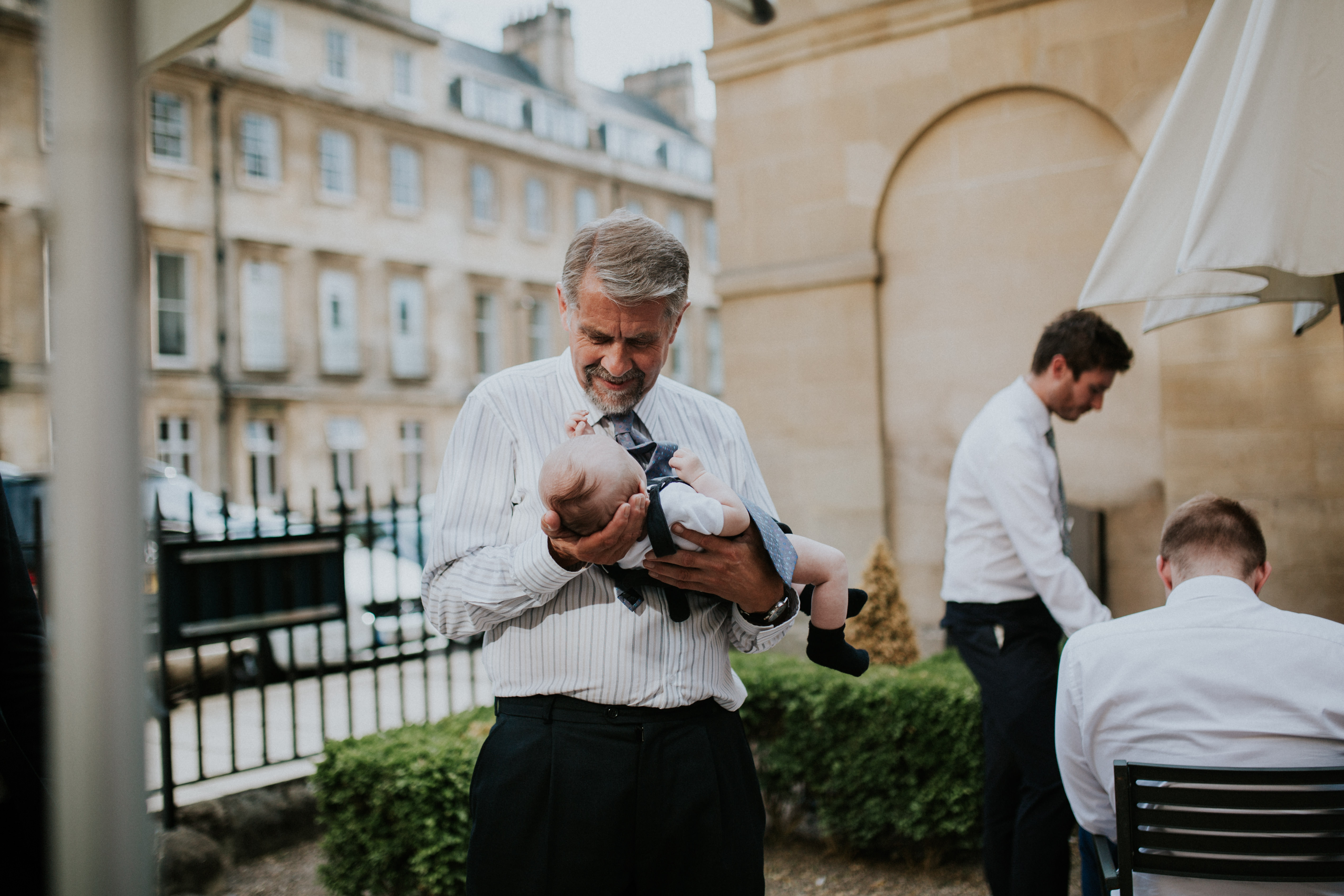 man holding baby