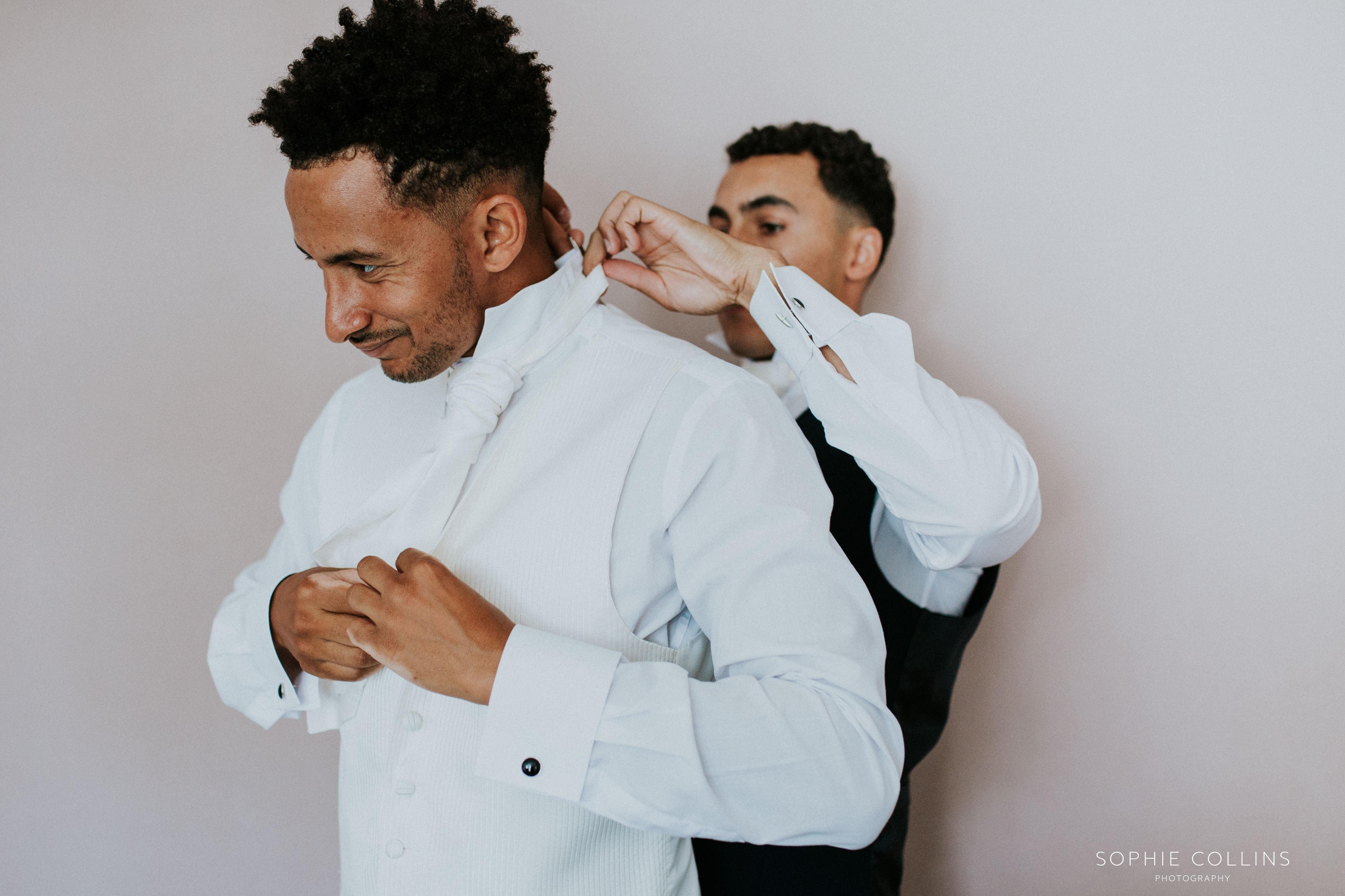 best man dressing groom