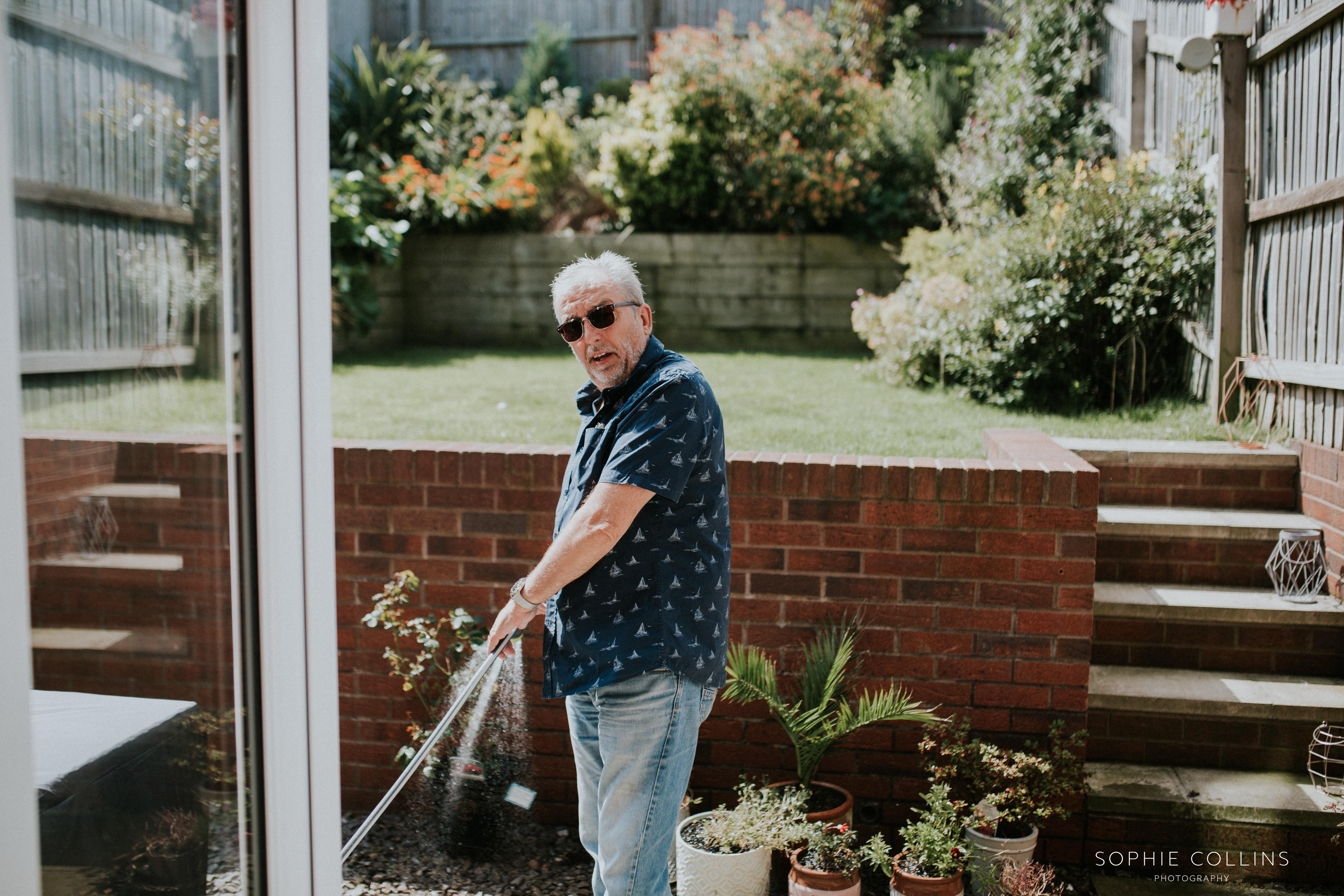 dad watering flowers