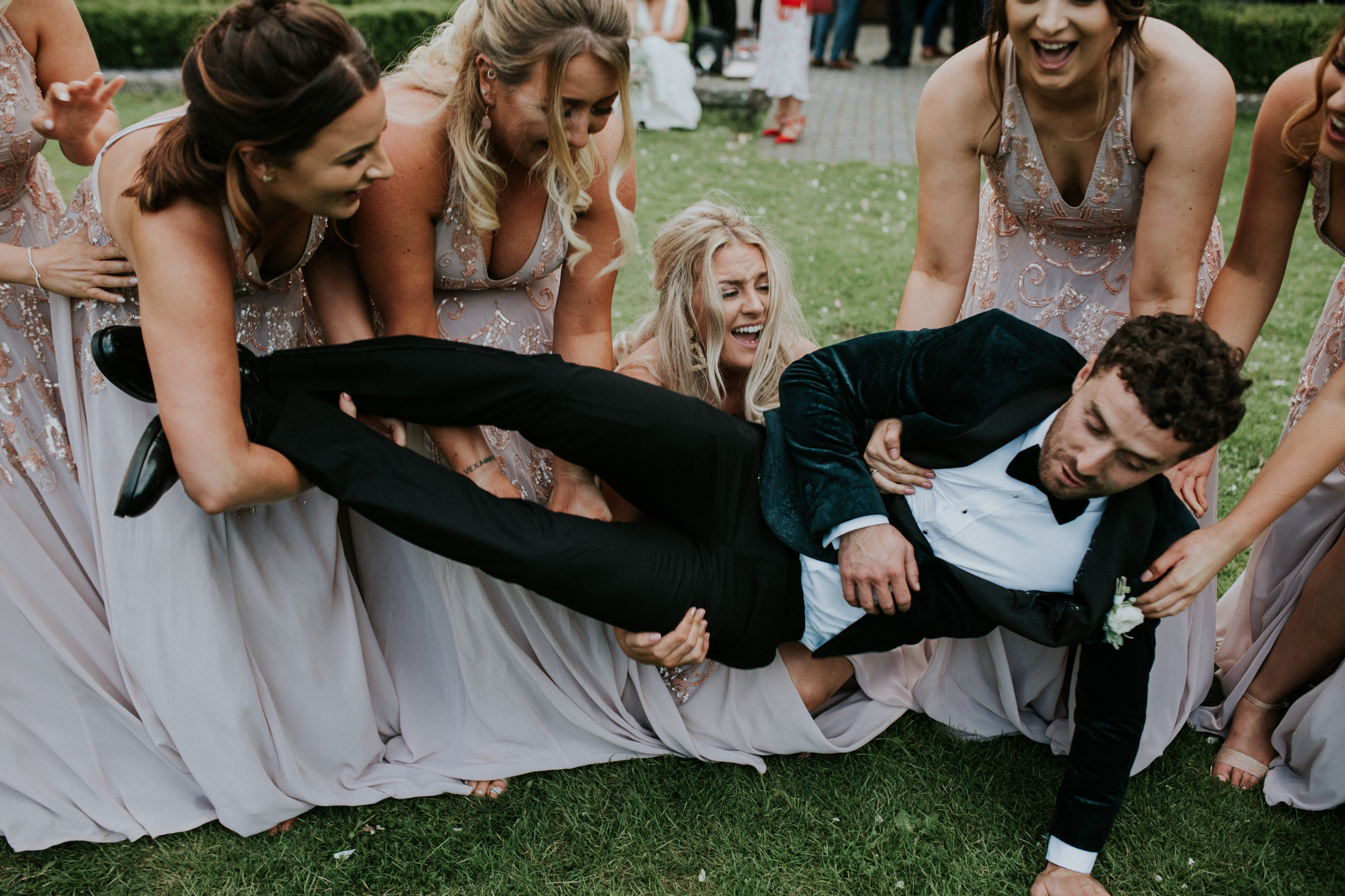 bridesmaids dropping the groom